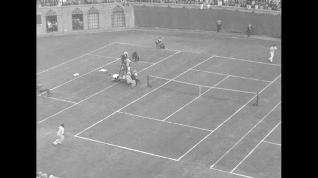 'California youth wins tennis title Forest Hills NY 21year John Doeg beats Frank Shields 1614 in final set for singles crown' / three action shots...