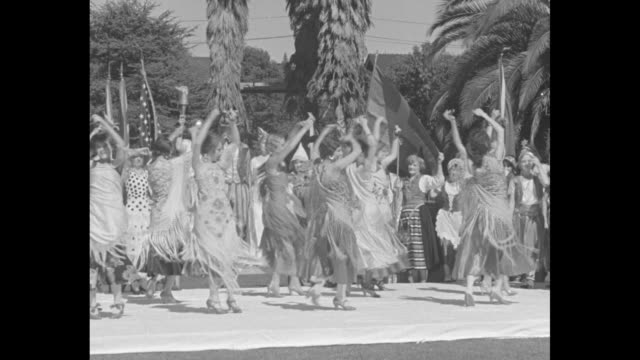 californians step lively in fiesta los angeles dancers put plenty of pep in international gathering staged at the ambassador gardens / vs women... - neckwear stock videos and b-roll footage