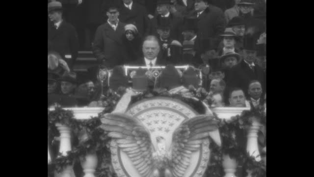 calvin coolidge congratulates the president / outgoing pres calvin coolidge stands at lectern with presidentelect herbert hoover coolidge smiles /... - herbert hoover us president stock videos & royalty-free footage