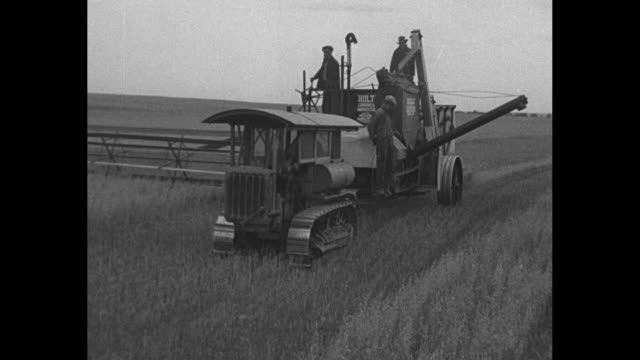 canada's new deal superimposed on farm equipment / vs a combine harvester with a caterpillar track // sot social credit party leader william aberhart... - caterpillar track stock videos and b-roll footage