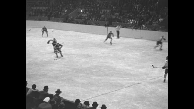 canadian hockey champs in action maple leafs tackle boston bruins in fast game at toronto / vs hockey game in progress - bianco e nero video stock e b–roll