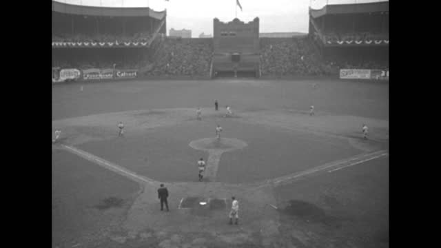 """champions of the world,"" fade in baseball game / crowd in stands at the polo grounds / yankees manager joe mccarthy shaking hands with owner jacob... - number 4 stock videos & royalty-free footage"