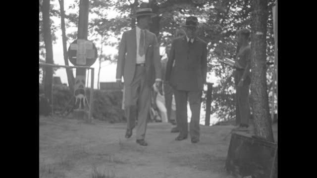 stockvideo's en b-roll-footage met chief inspects boy scout camp north east md executive west and leaders visit rodney scout camps on the chesapeake / from above men walk across dock /... - maryland staat