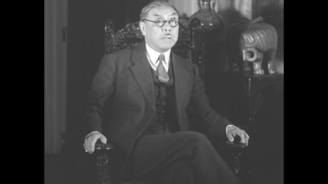 "dr. w. w. yen gives his nation's views on far east crisis involving japan"" / huiqing yen , chinese envoy to us, sits in chair addressing camera /... - manchuria stock videos & royalty-free footage"