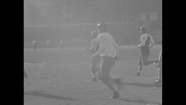 """""""cincinnati grid hopes!"""" superimposed on football players / pan of the vast stadium rebuilt by the wpa / players rush at the tackle dummy / l-r tay... - wpa stock videos & royalty-free footage"""