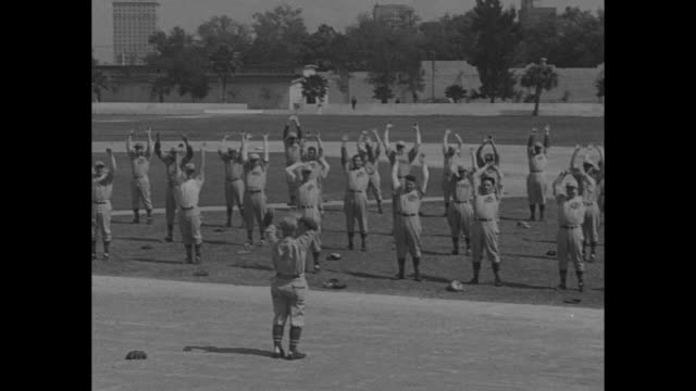 Cincinnati Reds Get Set For '37 Season / title Tampa Fla superimposed over manager Chuck Dressen talking to team on field / VS Reds running toward...