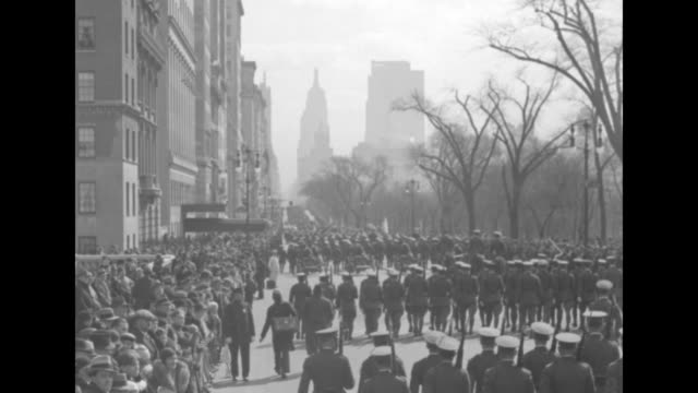 """""""city hails defenders on army day"""" / soldiers marching in formation down street led by two soldiers on horses / shot from behind of soldiers marching... - west point new york stock videos & royalty-free footage"""