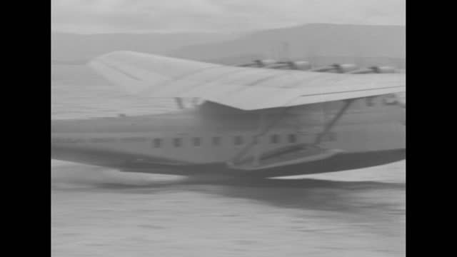 """""""clipper - tragedy claims plane and crew"""" / samoan clipper on ground, people around it / flight crew in row including captain ed musick / musick /... - samoa stock videos & royalty-free footage"""