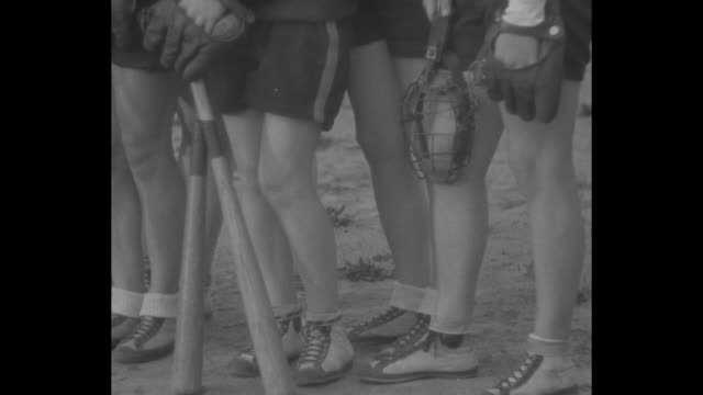 coed nine in fast ball tilt eureka cal athletic college girls display real form in exciting contest / team of female students standing with their... - baseball bat stock videos & royalty-free footage