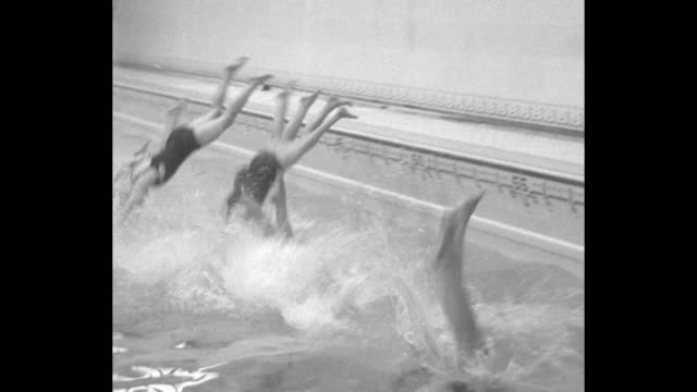 """co-ed students swim for degree, corvallis, ore - girls attending state college must be qualified mermaids to pass courses"" / women in bathing suits,... - oregon us state stock videos & royalty-free footage"