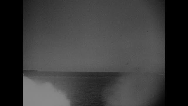 """convoys - mediterranean ships in fierce sea battle"" / rock of gibraltar from ship deck / ship's wake in fg, british ship convoy in bg / two... - binoculars stock videos & royalty-free footage"