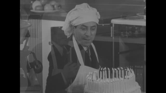 """cooking up a surprise"" superimposed over jack putting bowl into oven/ jack pearl aided by the duncan sisters mixing a huge cake for president... - back lit stock-videos und b-roll-filmmaterial"