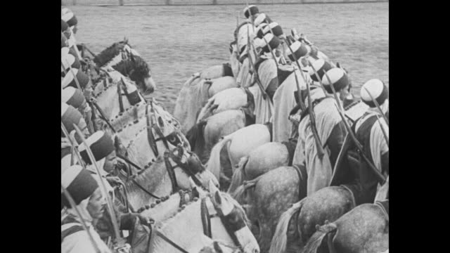 vídeos de stock e filmes b-roll de crack spahi cavalry shows france how sons of desert ridecolonial troopers from north african wastes display horsemanship at vincennes exposition /... - 1931