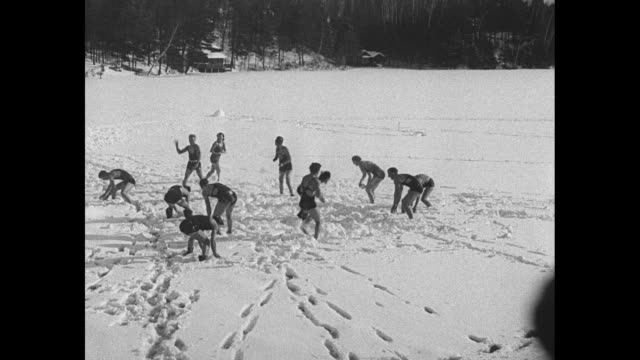 """""""cracked icemen? pine island park, nh -- many are cold, but few are frozen! manchester brownies plunge into mid-winter swim fest"""" / young men and... - diving platform stock videos & royalty-free footage"""