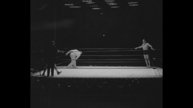 'Crash As Crash Can Los Angeles A battle of giants Veteran Strangler Lewis defeats Don George for western mat title in thrilling clash' / announcer...