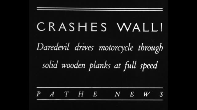 crashes wall daredevil drives motorcycle through solid wooden planks at full speed / ms daredevil boe huckman standing beside wooden planks can see... - stunt person stock videos & royalty-free footage