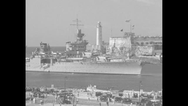 morro castle with uss indianapolis in havana bay in front of it / wall of morro castle in foreground, uss indianapolis in background / navy crewman... - cuba stock videos & royalty-free footage
