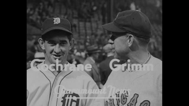 Cubs Take Opener 30 / players walk onto Navin Field before game / title Cochrane Grimm superimposed over Detroit Tigers manager Mickey Cochrane and...