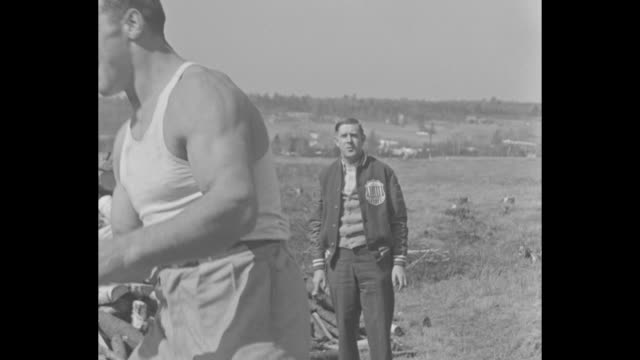 da preem he eats la moine champion carnera polishes off a few chickens for dinner at maine training camp he fights max baer for title in june /... - primo carnera stock videos and b-roll footage
