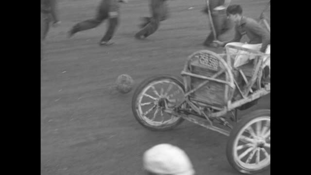daredeviltry thrills crowd at speedway risky feats mark congress of men who like to take a chance / vs two cars playing auto polo people on side with... - scrambling bildbanksvideor och videomaterial från bakom kulisserna