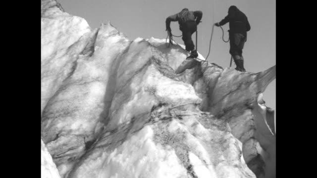 daring climbers conquer majestic mount rainier pathe news cameraman risks fatal fall into treacherous crevasses to reach peak 14408 feet high / two... - crevasse stock videos & royalty-free footage