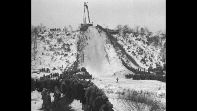 Daring leaps mark title ski tourney Gary Ind Spectacular jumps and spills opening meet of winter season at Ogden Dunes / two shots of skiers jumping...
