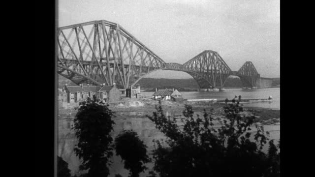 decorate biggest span in scotland firth of forth daring workmen paint giant arches of noted cantilever bridge 1710 feet long / ws railroad bridge... - fluss firth of forth stock-videos und b-roll-filmmaterial