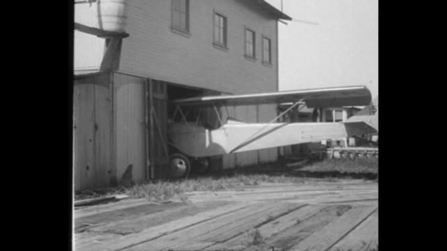 demonstrate new plane for parking stinson beach calif aircraft that can be housed in garage taken out for test flight / inventor jacob p sellmer... - airplane tail stock videos and b-roll footage