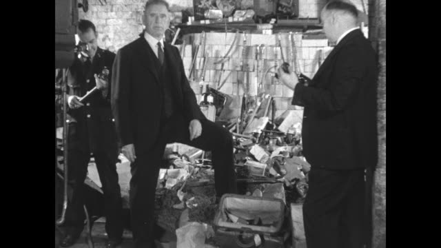 vídeos de stock e filmes b-roll de destroy narcotics new yorknarcotic division of new york police burn $250000 worth of dope seized during 8 months nov 2 1931 / sot man who is probably... - 1931