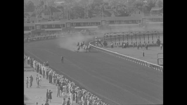 detroit derby / wide ls spectators in stands and racetrack / ls horses and jockeys parade to post / ms spectators in stand / ls race starts... - straw hat stock videos & royalty-free footage