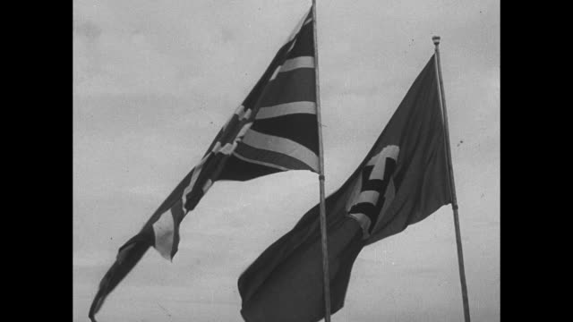 vidéos et rushes de die zweite begegnung chamberlain hitler in godesberg am rhein / vs british and german flags wave / high angle view of bad godesberg and the rhine... - vue globale