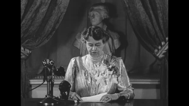 dime plea first lady urges aid for paralysis / two shots of eleanor roosevelt wife of president franklin roosevelt sitting at desk in room in white... - dime stock videos and b-roll footage
