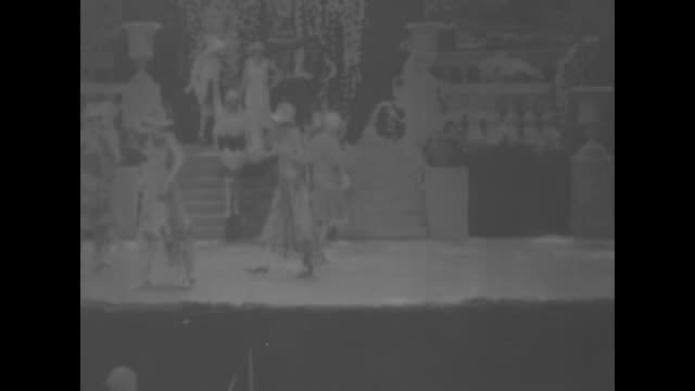 1920s fashion show features flapper dresses and fashion / woman in close-fitting cap, pearl necklaces, and fur stole / three women in hats twirl,... - sfilata video stock e b–roll