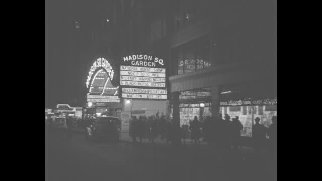 dobbin's in society / night ext entrance of madison square garden in new york city marquee touts the national horse show / vs socialites arrive /... - fort myer stock videos and b-roll footage