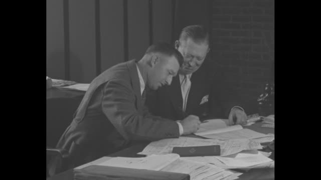 vídeos de stock e filmes b-roll de dressen to lead the reds / new cincinnati reds manager dressen on left sitting at desk with general manager larry macphailan and signing his contract... - assinar