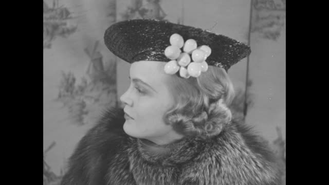 """""""easter bonnets!"""" superimposed over face of hat model with veil / fashion show of hats / hat model with ribbons and fruit / model in fur coat with... - straw hat stock videos & royalty-free footage"""