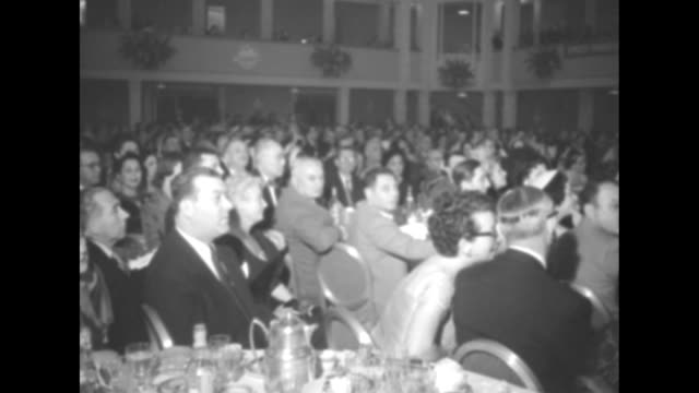 eddie cantor honored on 60th birthday superimposed over ms entertainer eddie cantor wearing a tuxedo and seated next to his wife ida at the gala... - plakette stock-videos und b-roll-filmmaterial