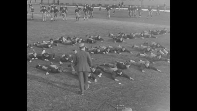 """""""editor's note: knute k. rockne, notre dame's famous football coach, who lost his life in air accident near emporia, kansas, is shown here with his... - practice drill stock videos & royalty-free footage"""