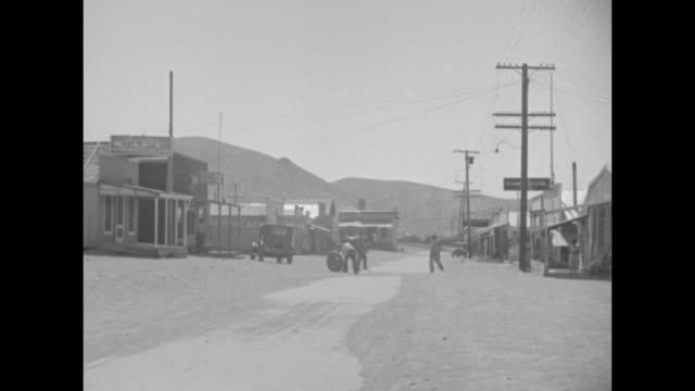 editor's note these pictures show life in one of the gold mining camps in california after the day's work is done a cross section of pathe news' plan... - shaving stock videos & royalty-free footage