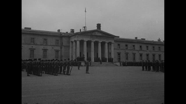 eisenhower c in c at sandhurst britain's west point/ ws ext british cadets stand at attention outside the old college building at royal military... - music stand stock videos & royalty-free footage