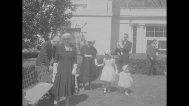 vídeos de stock, filmes e b-roll de eisenhowers pose for spring photo superimposed over white house / eisenhower family exiting the white house / ike's mother in law elivera doud walks... - dwight eisenhower