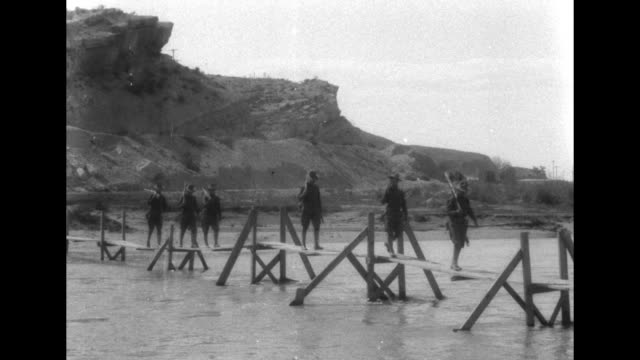 """""""el paso, texas, american troops build temporary bridge across the rio grande to facilitate communication with troops in mexico"""" / line of soldiers... - 1910 stock videos & royalty-free footage"""