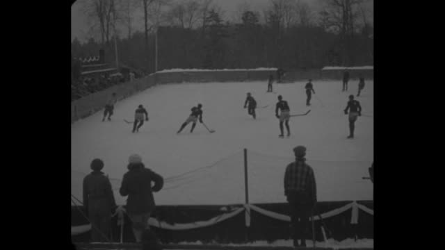 elis beat michigan in hockey clash lake placid club ny yale defeats wolverines 71 in stirring winter sports contest / various action shots from game... - lake placid town stock videos and b-roll footage
