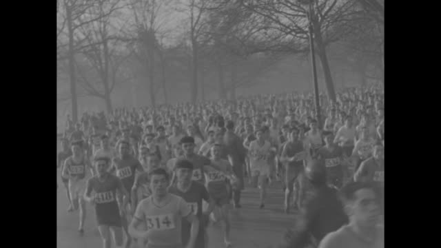 """""""england invades france! paris - great britain's runners down french in 6-mile cross-country run! archibald wilson leads 1,500 home to win season's... - french language stock videos & royalty-free footage"""