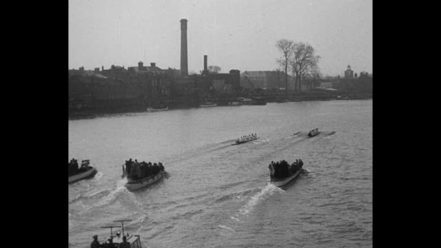 """""""england"""" superimposed over boat racing / vs cambridge-oxford crew race on river thames / one of the gallery boat following / vs shells racing to... - 1923 stock videos & royalty-free footage"""
