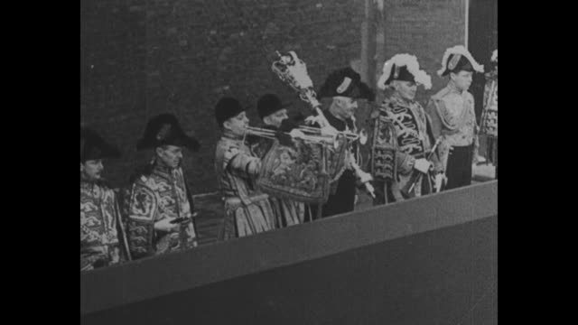 vídeos de stock, filmes e b-roll de england's tribute to the king superimposed over funeral procession for king george v / people at train station watching as funeral train arrives /... - gloucester estados unidos