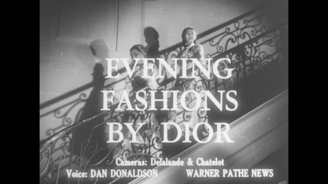 Evening Fashions by Dior superimposed over two models walking down steps wearing dresses that differ only in the color of the embroidery on their...
