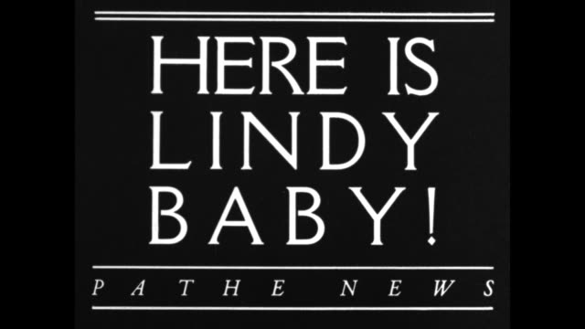 extra / title card here is lindy baby / title card every american is asked to aid in search for kidnapped child / still photo of lindbergh baby... - charles lindbergh stock videos & royalty-free footage