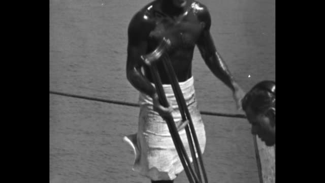 Farmer again swim champ Toronto long distance Lake Ontario swim captured by American for 3rd time Marvin Nelson of Iowa conquered icy waters for...