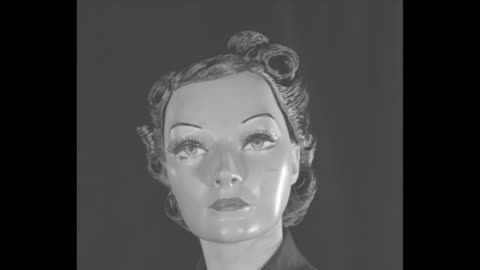"""vidéos et rushes de """"fashions drop their mask!"""" superimposed over group of four female face masks / four seated models, each in a dress, with face masks and wigs... - enlever"""